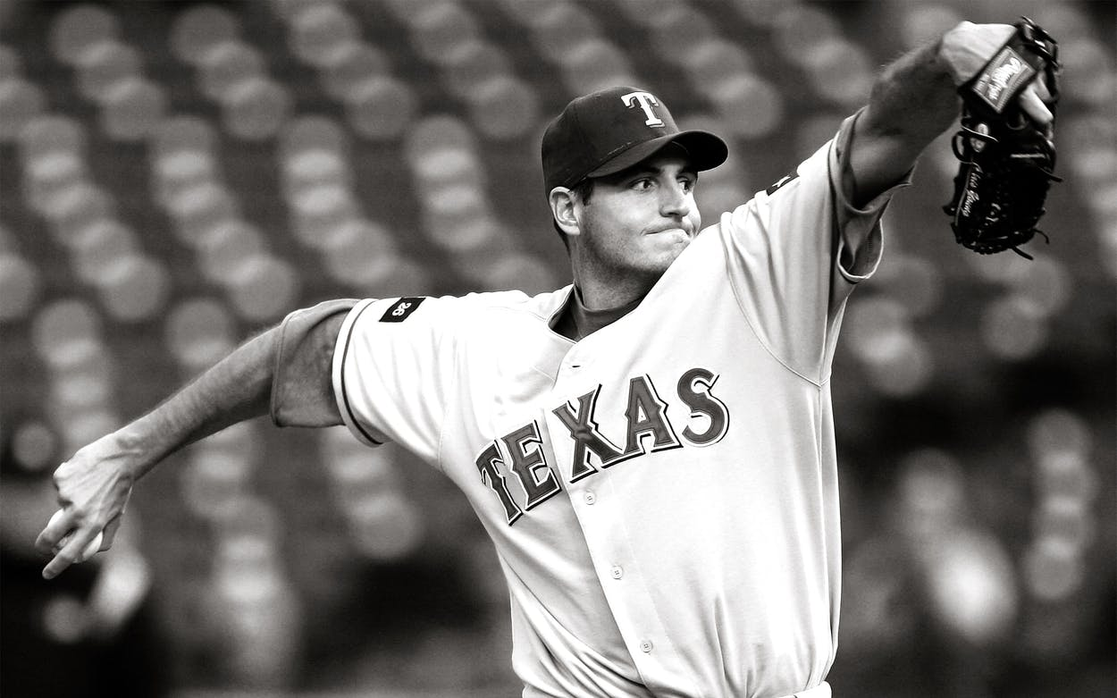 Chris Young #49 of the Texas Rangers pitches against the Oakland Athletics during an MLB game at McAfee Coliseum on May 3, 2005 in Oakland, California.