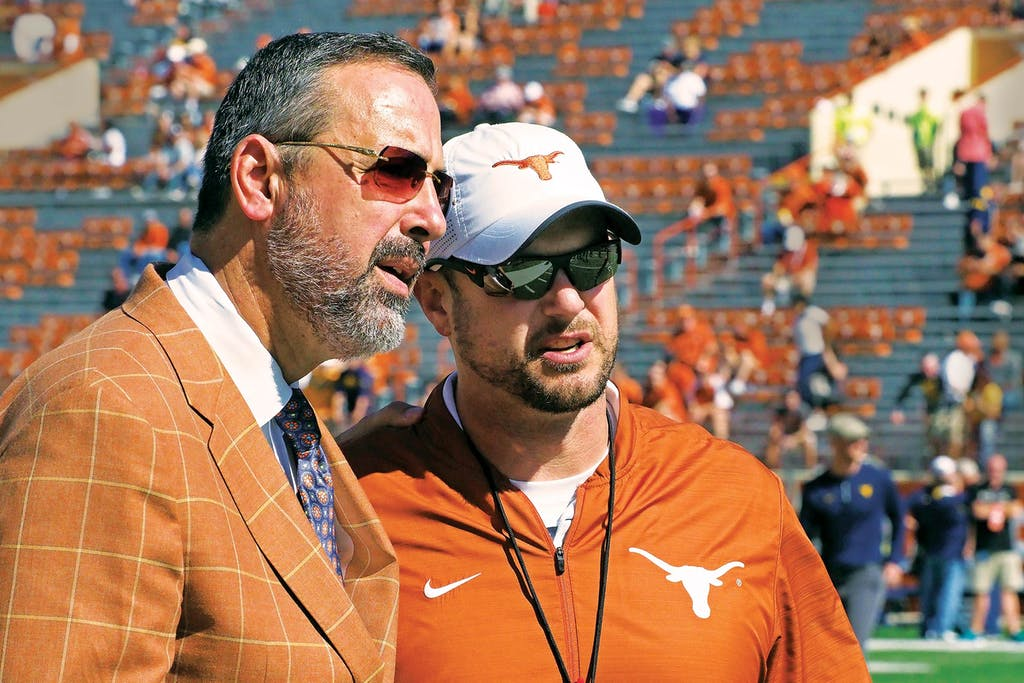 Texas athletic director Chris Del Conte with then–head coach Tom Herman.