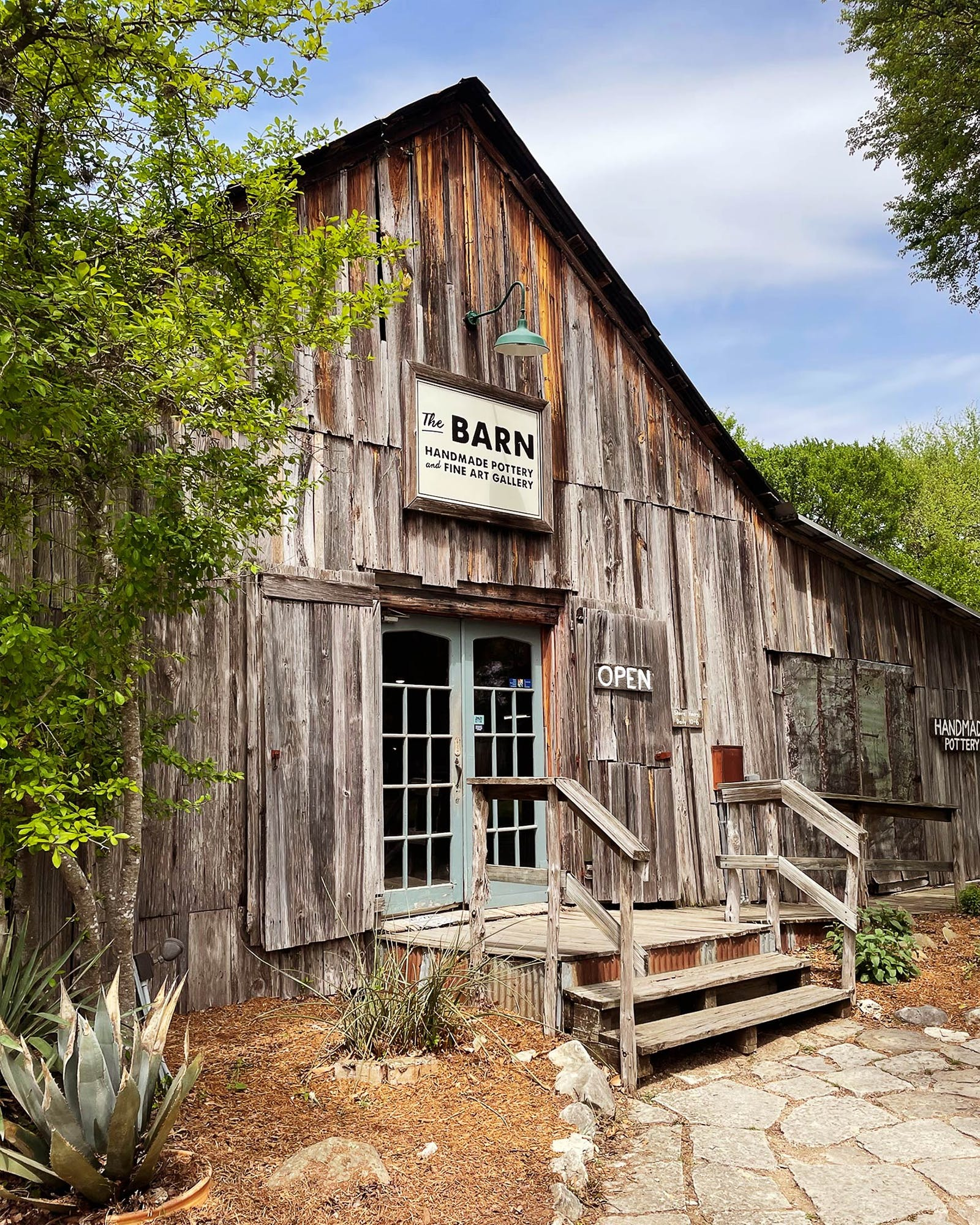 At The Barn Handmade Pottery and Fine Art Gallery in Gruene, you're likely to see an artist or two in action.