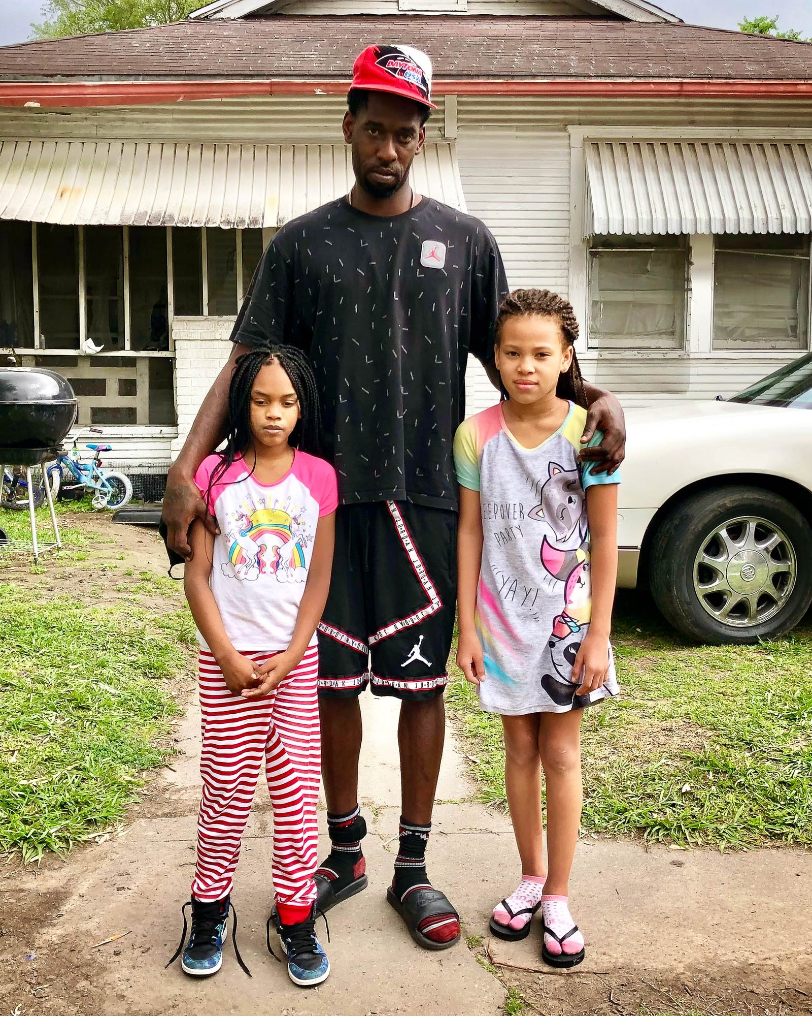 Ricarro Middleton and his two eldest daughters.