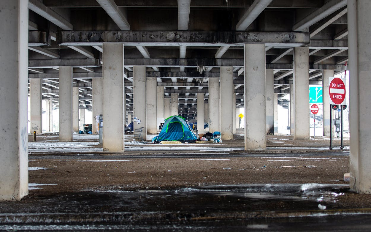 A homeless camp under a bridge on I-35 in Austin, Texas