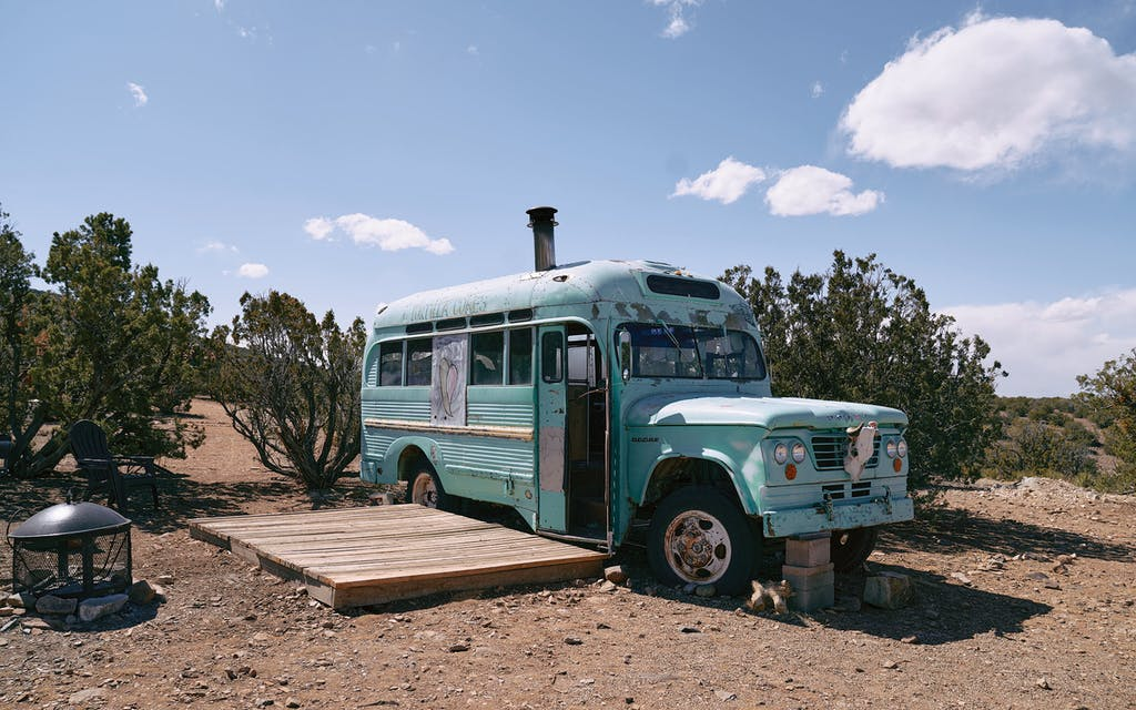 A bus that serves as lodging at the Shanti Community, near Madrid.