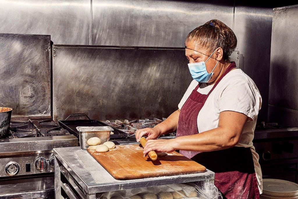 flour tortilla rolling at tia doras bakery