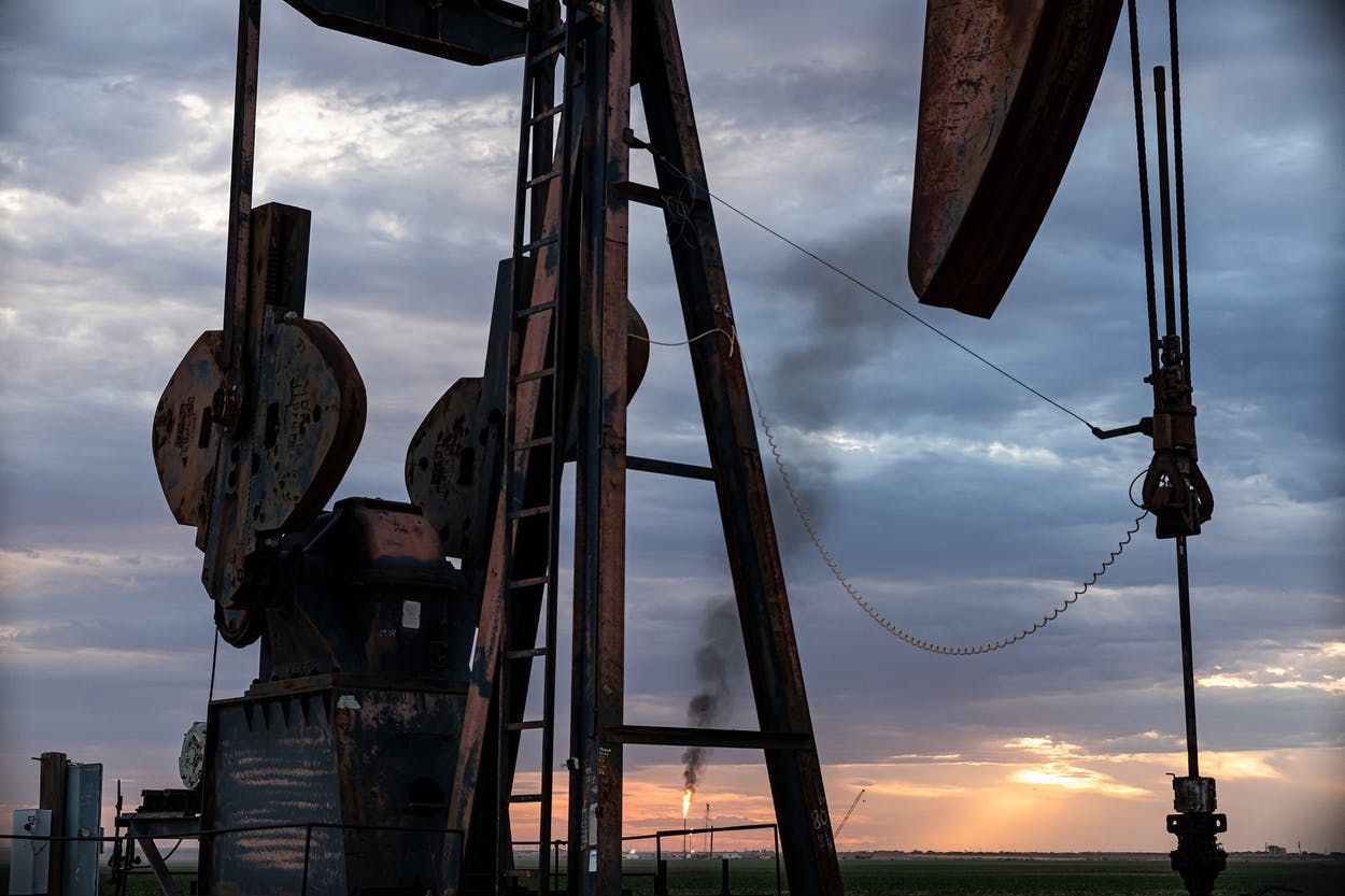 Pump jack with flare in the distance near Knott.