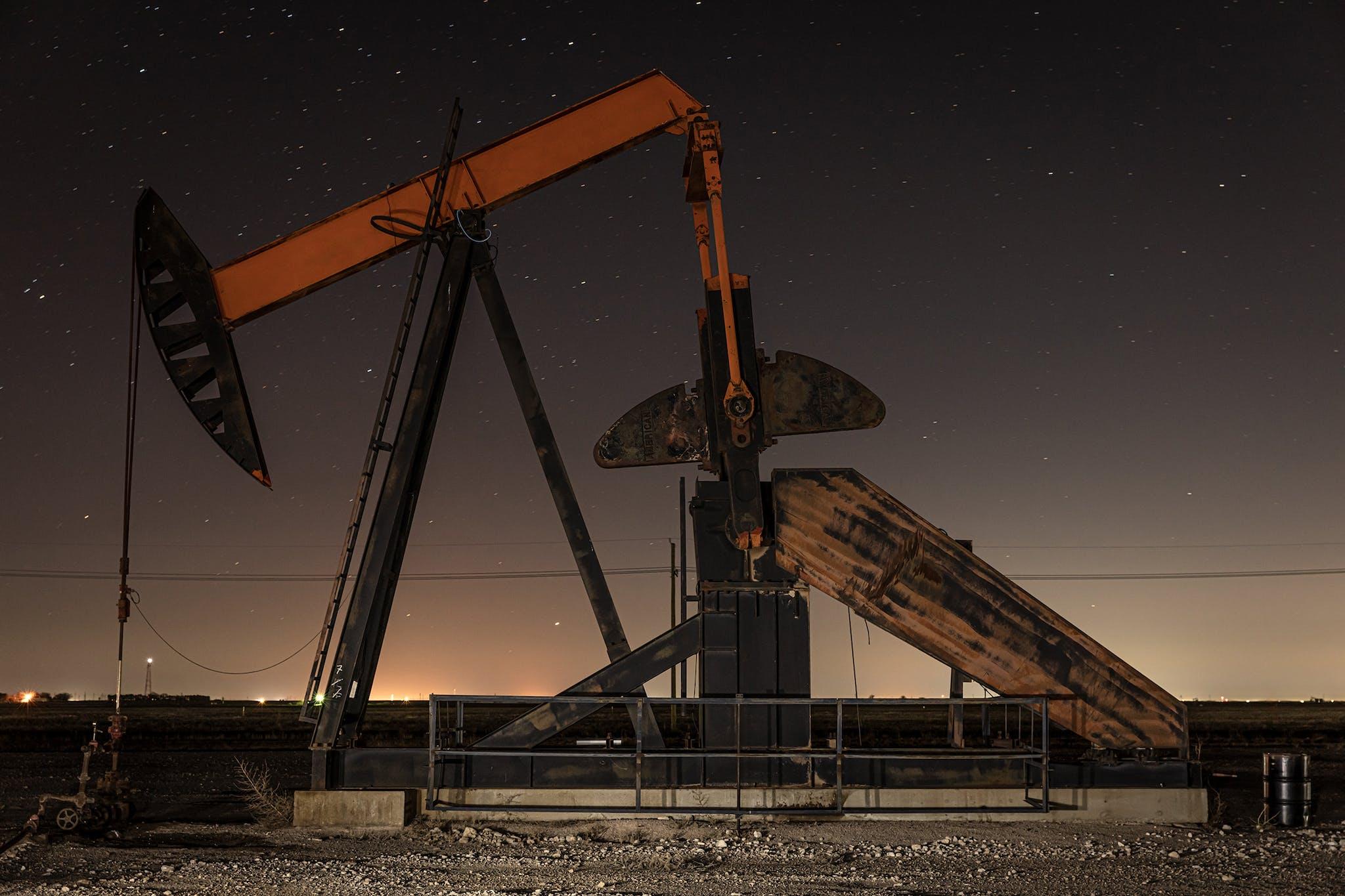 Pump jack at night along Hwy 349, in Martin County.