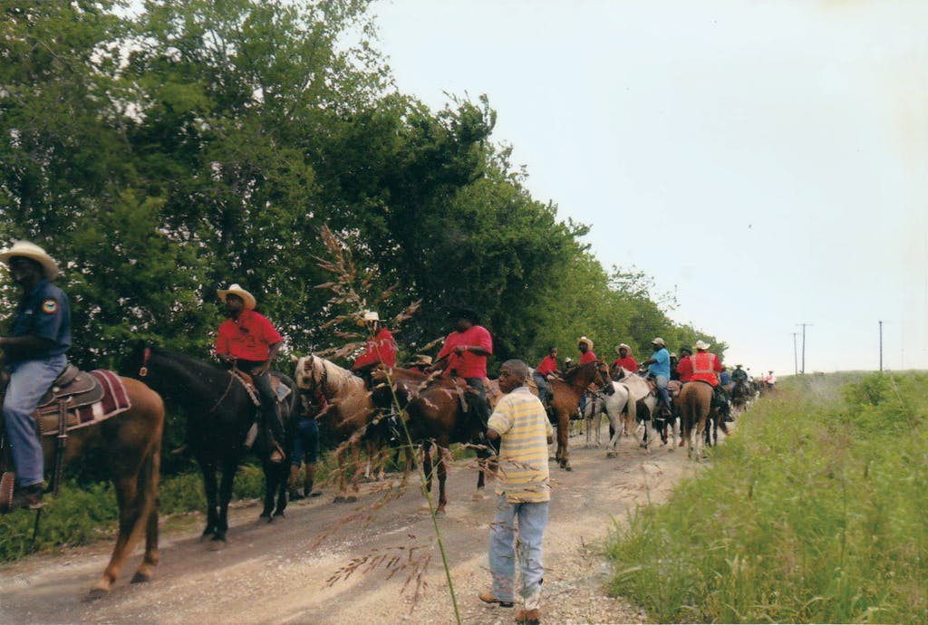 James Ferrell's Black Frontier Riding Club on a trail ride to the Juneteenth celebration at Comanche Crossing, year unknown.