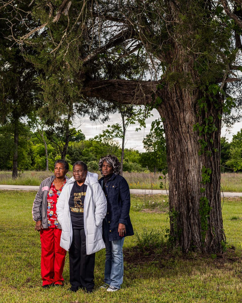 Pamela, Patricia, and Evelyn Jean Baker under their family oak tree at Booker T. Washington Park, on April 21, 2021.