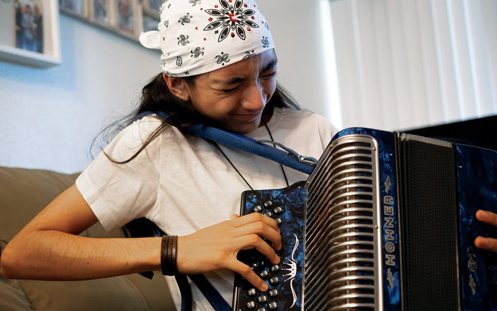 Christopher Ramirez practices accordion at his home in San Antonio on May 5, 2021.