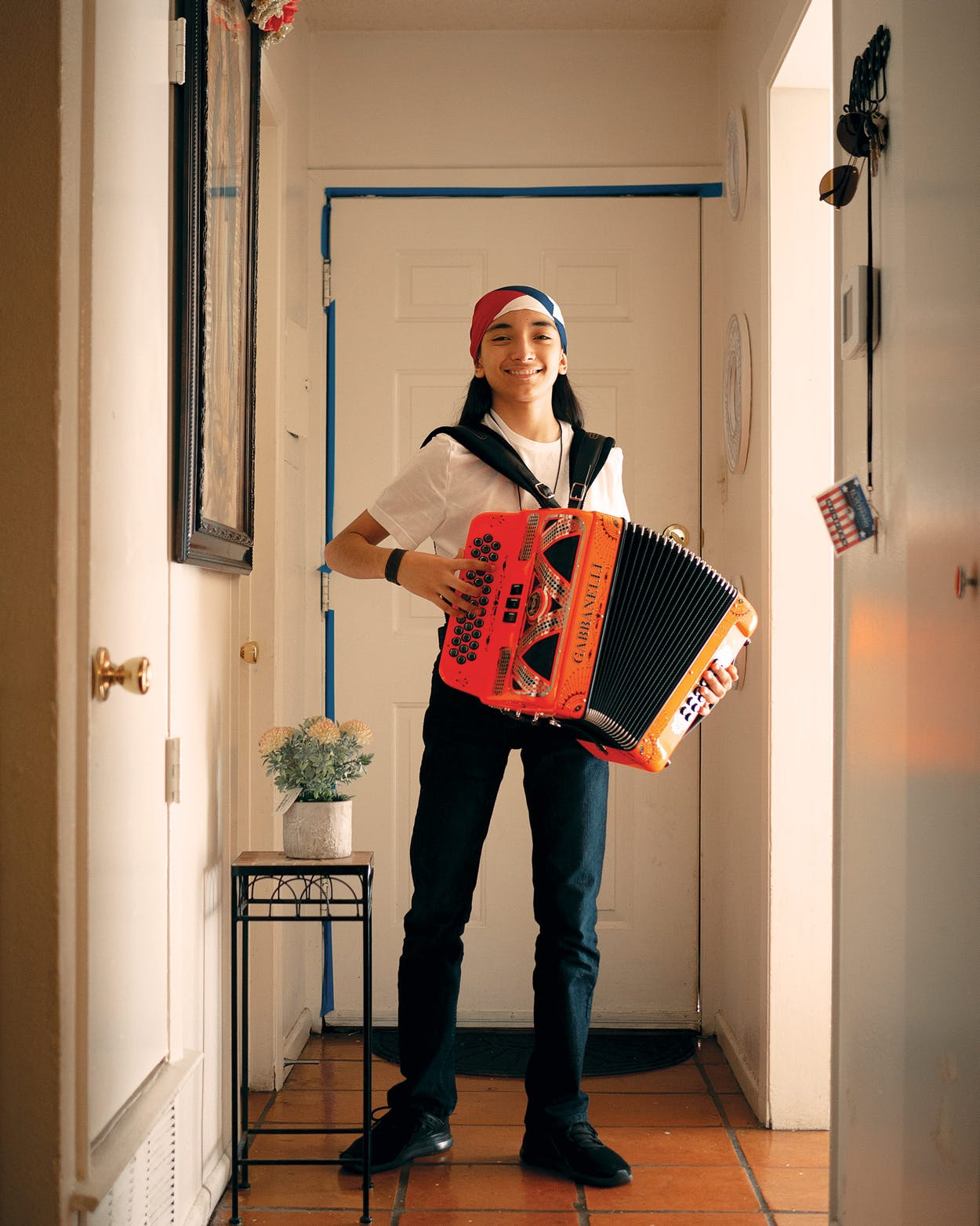 Christopher Ramirez with his accordion at his home on May 5, 2021.