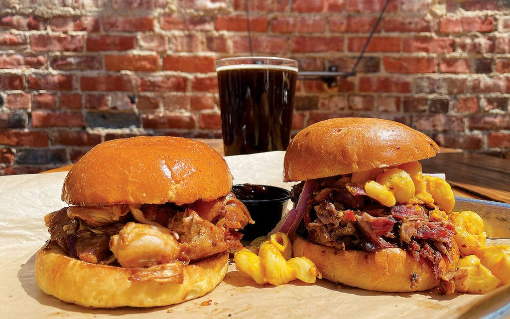 The smoked jackfruit (left) and MacRib sandwiches and a brown ale at Intrinsic Smokehouse and Brewery, in Garland.