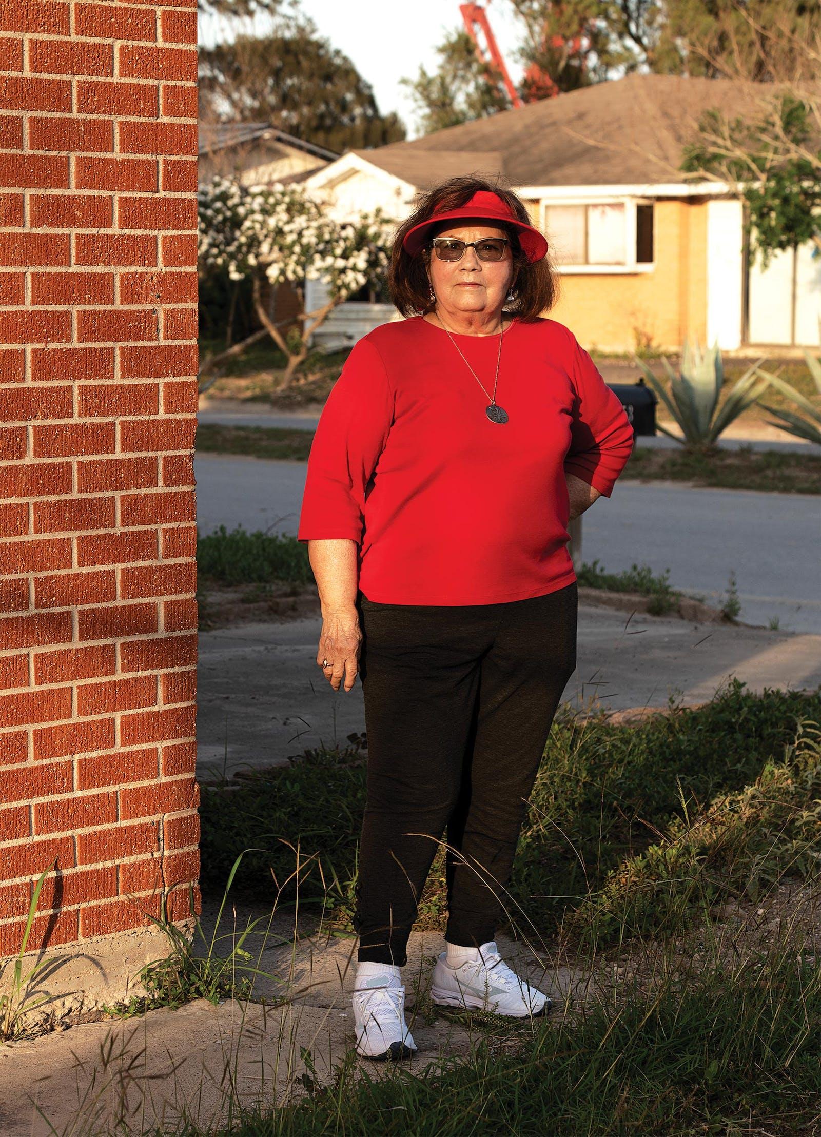Celia Garcia outside her home in Boca Chica.