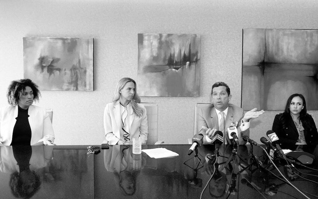 Tony Buzbee and three of his associates, Maria Elena Holmes, Cornelia Brandfield-Harvey, and Crystal Del Toro in Houston on March 19, 2021.