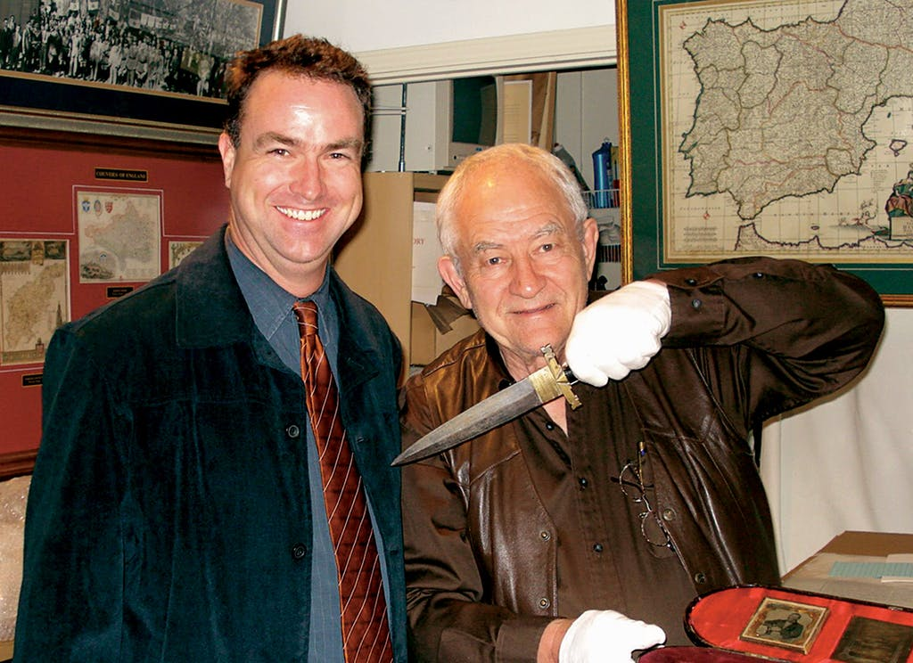Jim Guimarin (right) with customer Craig Stinson at the History Shop in 2007.