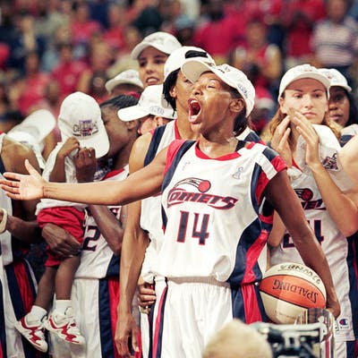 Cynthia Cooper, center, and the Houston Comets after winning game three of the WNBA Finals against the New York Liberty at the Compaq Center in Houston on September 5, 1999.