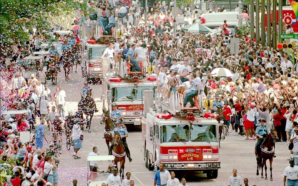 The Comets parade through downtown Houston on September 8, 1999, following their third WNBA championship win.