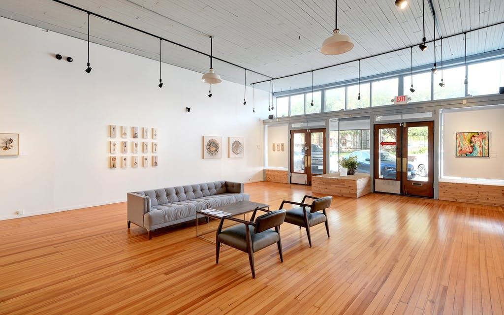 Leslie Lewis Sigler's art on display, at left, at Commerce Gallery in Lockhart.