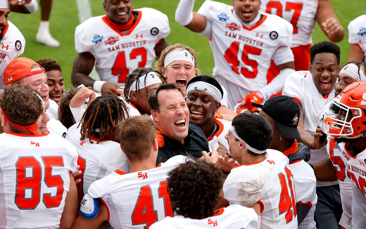 Sam Houston State Bearkats and head coach K.C. Keeler celebrate after defeating South Dakota State in the NCAA college FCS Football Championship in Frisco on May 16, 2021.