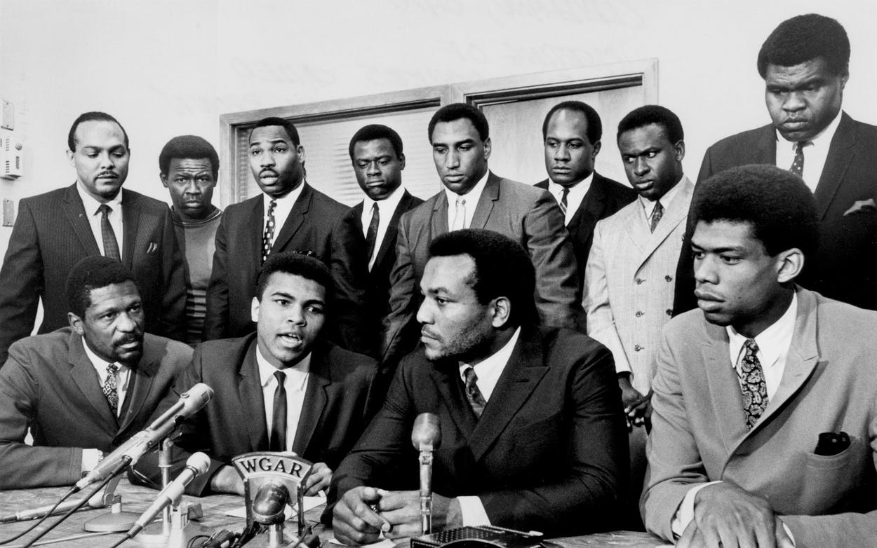 Former Cleveland Browns Hall of Fame running back Jim Brown presides over a meeting of top African-American athletes who supported boxer Muhammad Ali's refusal to fight in Vietnam on June 4, 1967. Pictured: (front row) Bill Russell, Muhammad Ali, Jim Brown, Lew Alcindor; (back row) Carl Stokes, Walter Beach, Bobby Mitchell, Sid Williams, Curtis McClinton, Willie Davis, Jim Shorter, and John Wooten.