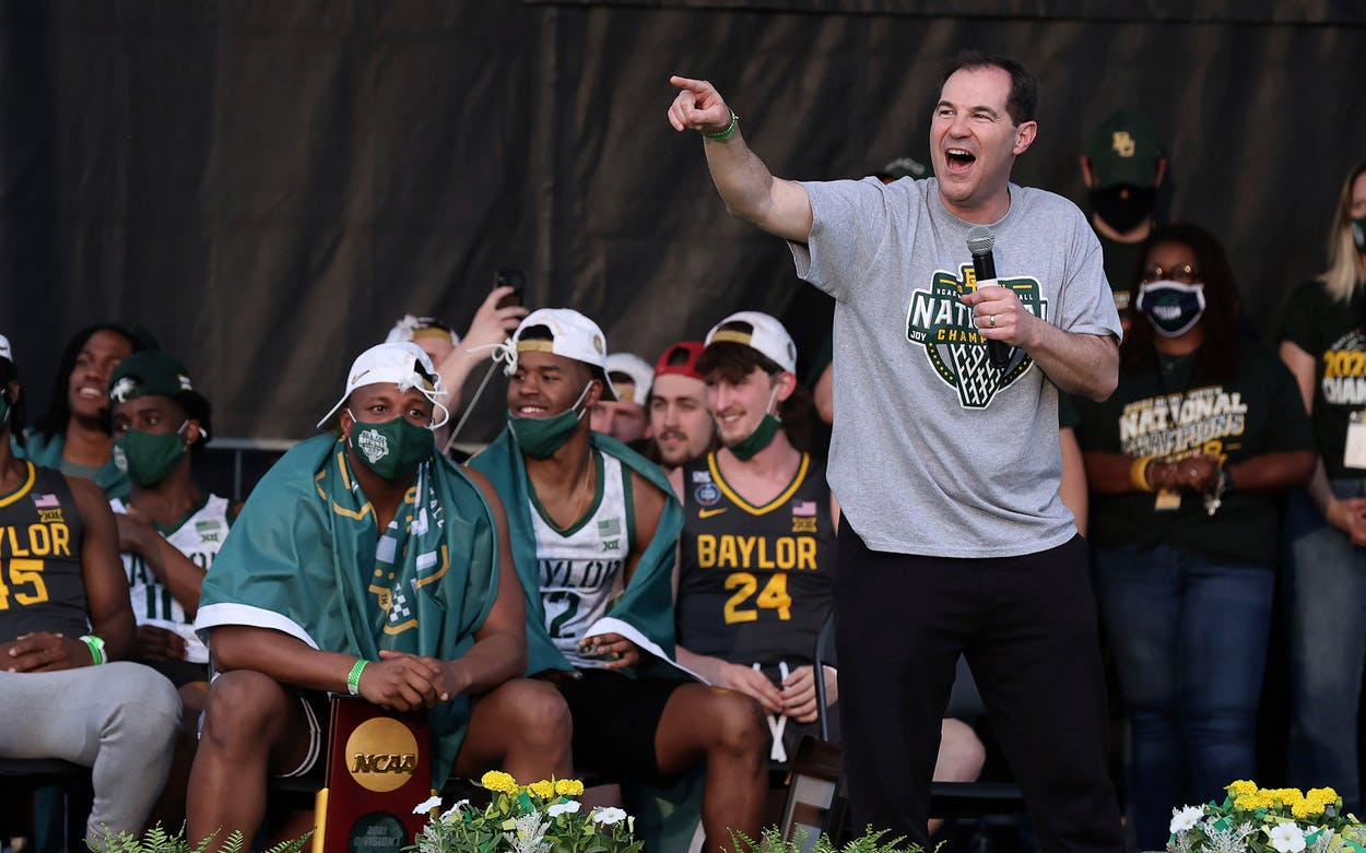 Baylor coach Scott Drew thanks former players as they celebrate their NCAA men's tournament championship Tuesday, April 13, 2021, in downtown Waco, Texas.