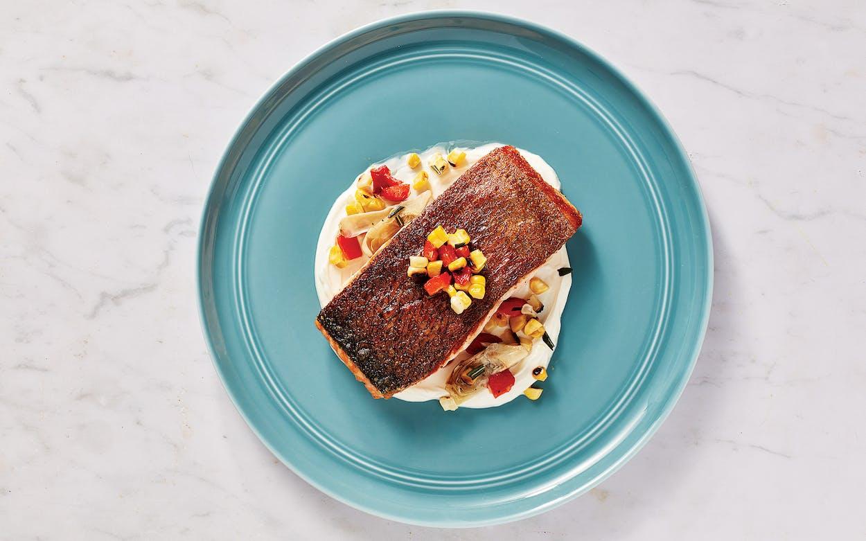 Crispy salmon with charred veggies.