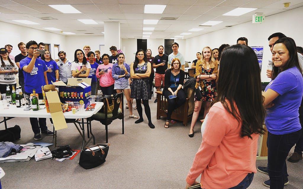 Emmy Ruiz (blue) and Natalie Montelongo (pink) address a crowd in Colorado in June 2016.