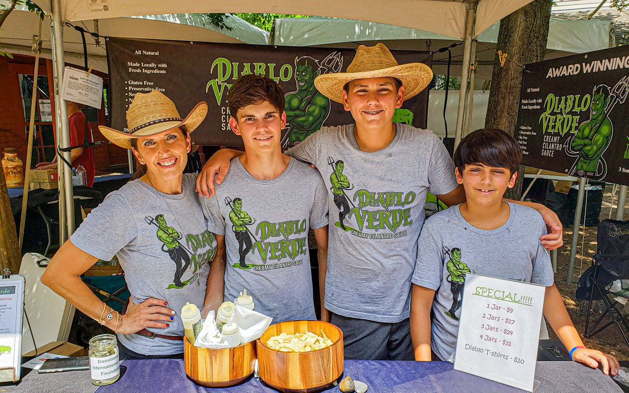 Traci Bourque-Johnson and her sons Ayden, Luke and George sell their Diablo Verde sauce at Fulshear's Farmer's Market.