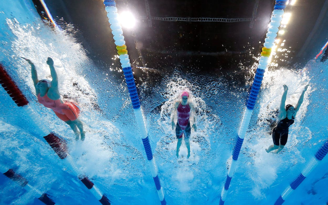 Camille Adams (center) competes in a final heat for the Women's 200 Meter Butterfly during the 2016 U.S. Olympic Team Swimming Trials on June 30, 2016 in Omaha, Nebraska.