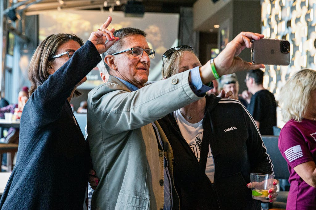 Former national security adviser Michael Flynn takes a selfie at the For God & Country Patriot Roundup convention, In Dallas, on May 28, 2021.