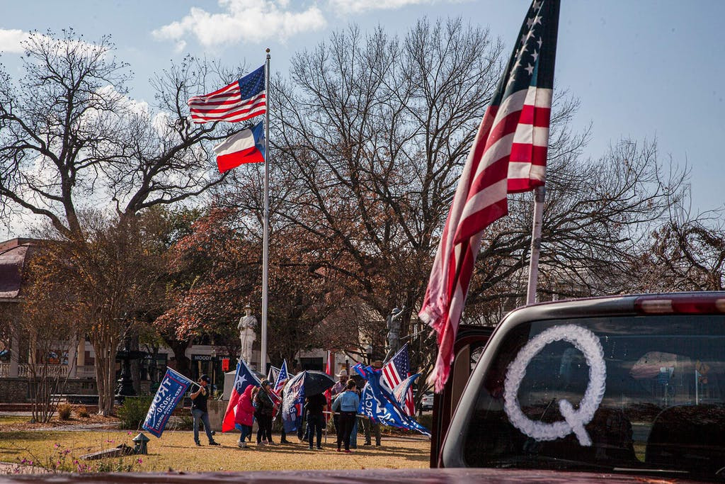 A QAnon symbol is displayed on a car as New Braunfels Trump Train members meet in support of President Trump at the Main Plaza on January 6, 2021 in New Braunfels.