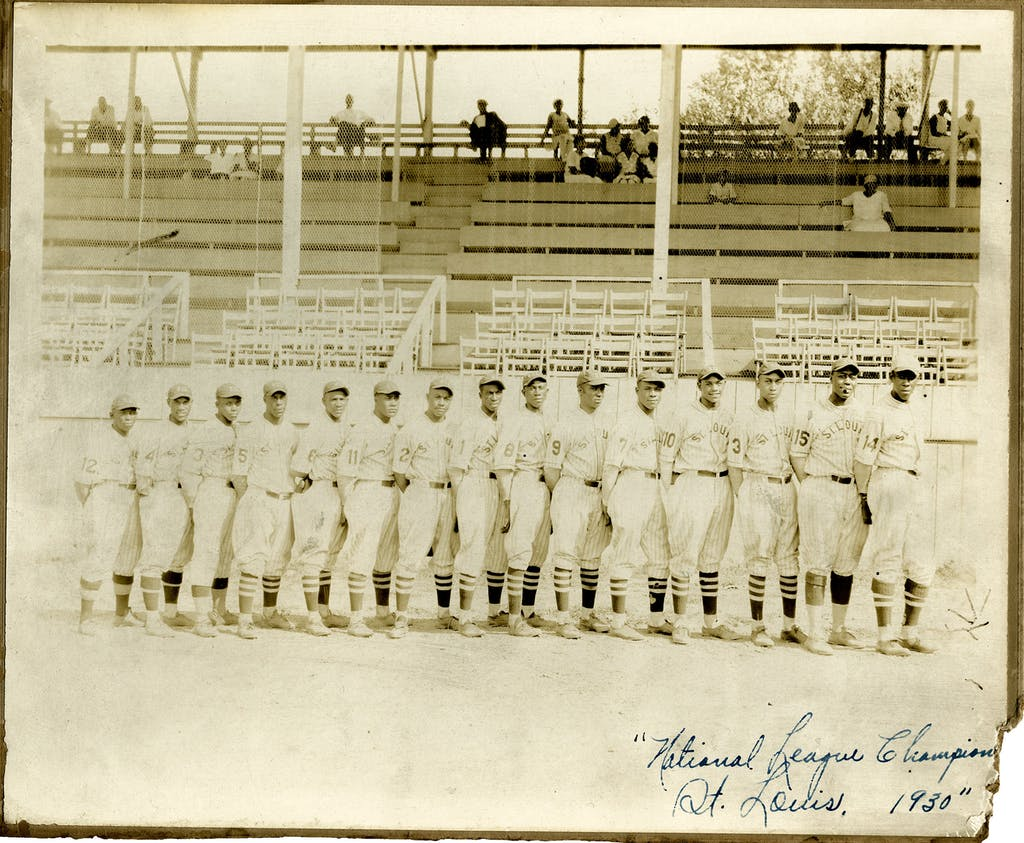 Wells played for the St. Louis Stars 1924-1931. He's pictured here in 1930, second from left, wearing the #4 uniform.