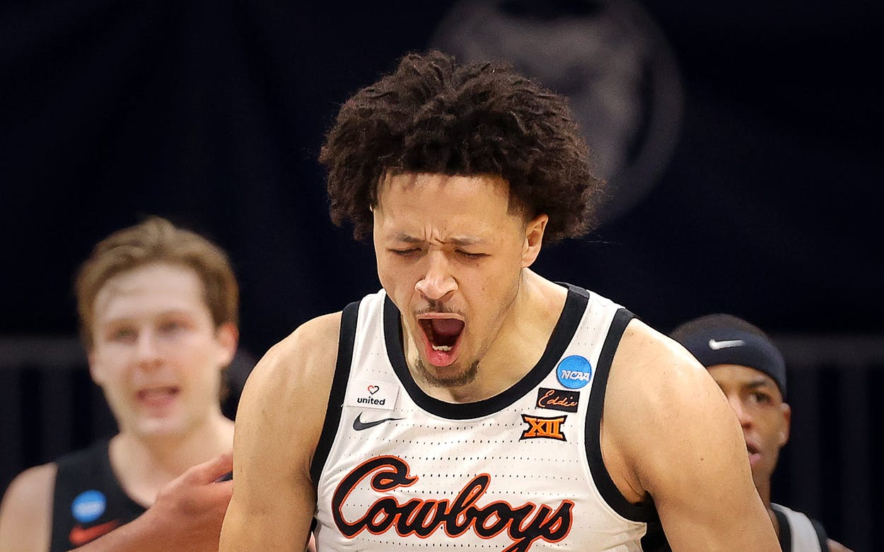 Cade Cunningham of the Oklahoma State Cowboys reacts against the Oregon State Beavers during the second half in the second round game of the 2021 NCAA Men's Basketball Tournament at Hinkle Fieldhouse on March 21, 2021 in Indianapolis, Indiana.