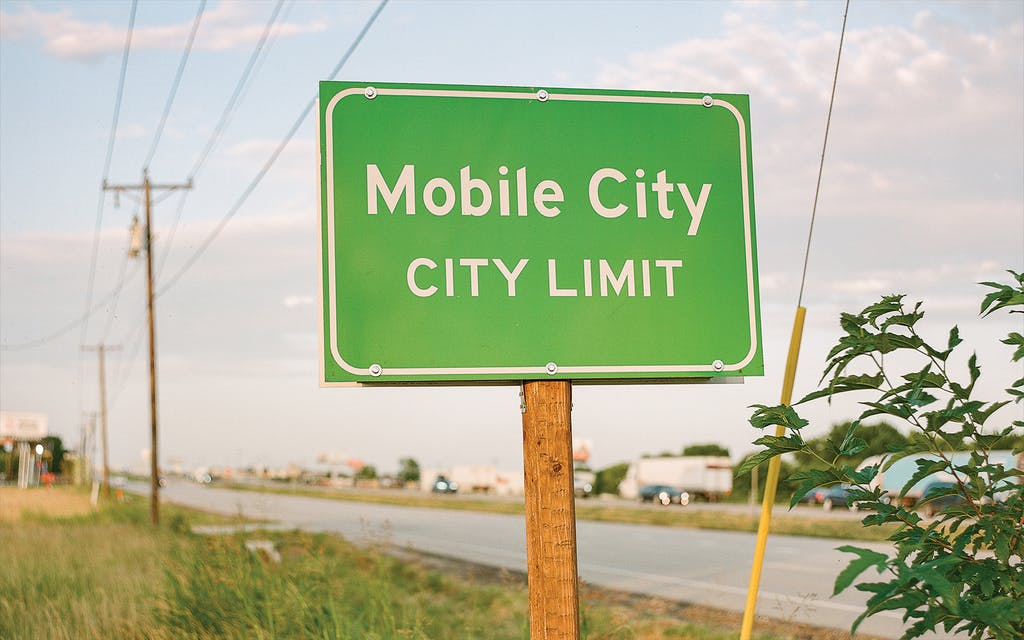 The city limit sign at the intersection of I-30 and Ivey Lane.