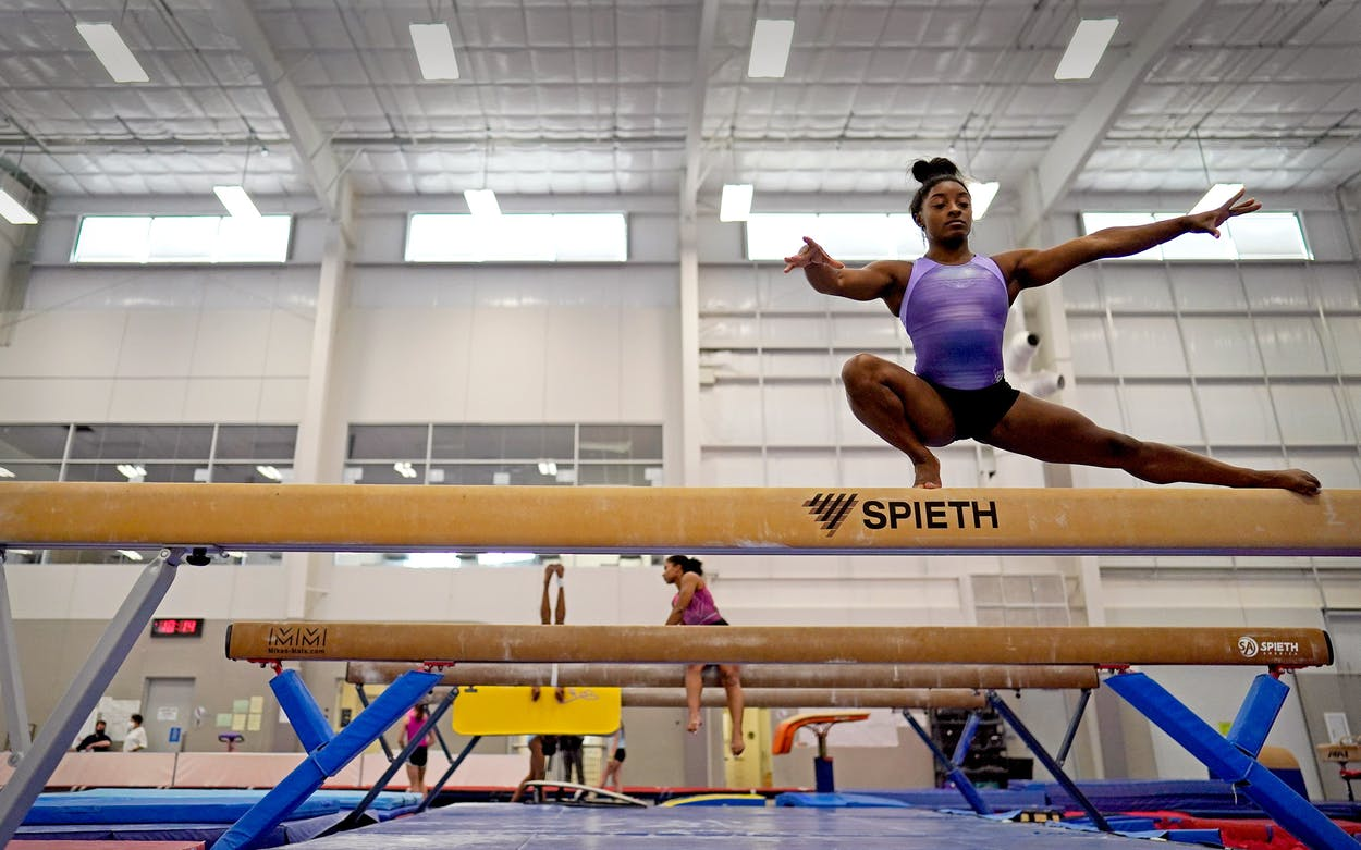 Reigning Olympic champion gymnast Simone Biles practices her balance beam routine during a training session Tuesday, May 11, 2021, in Spring, Texas.