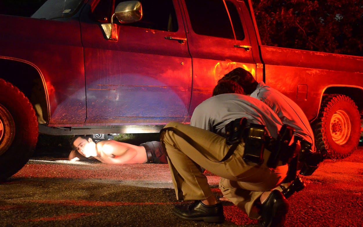A reenactment of Carlos DeLuna under the car in The Phantom.