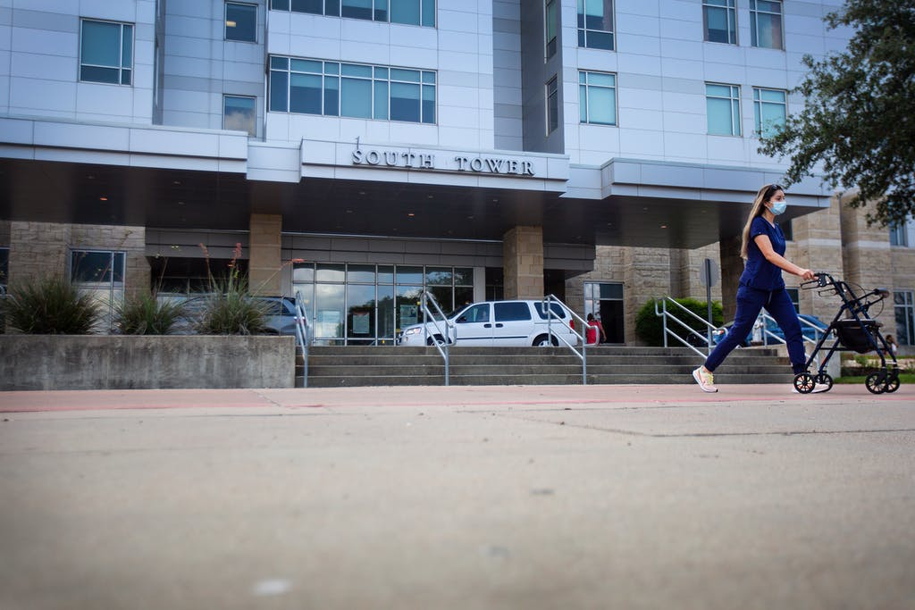 A nurse pushes a walker down a ramp at Baylor Scott & White Medical Center in Temple.