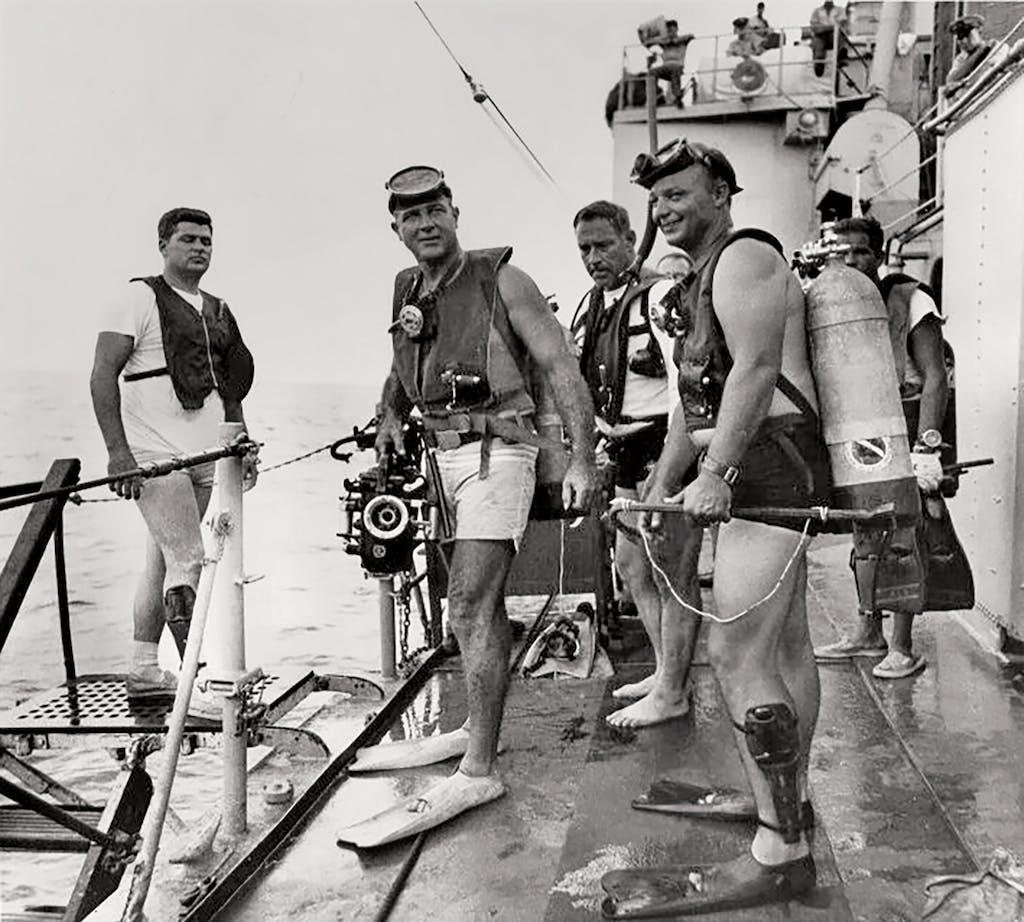 Divers, including Robert Woods (far left), preparing to jump in at Flower Garden Banks in 1967.