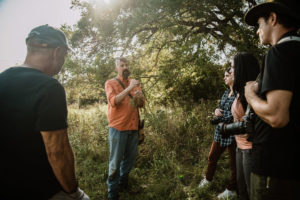 """Dr. Mark """"Merriwether"""" Vorderbruggen of Medicine Man Plant Co. leads a plant walkabout, teaching students how to identify and use wild plants for food and medicine on October 10, 2020 in Wimberley."""