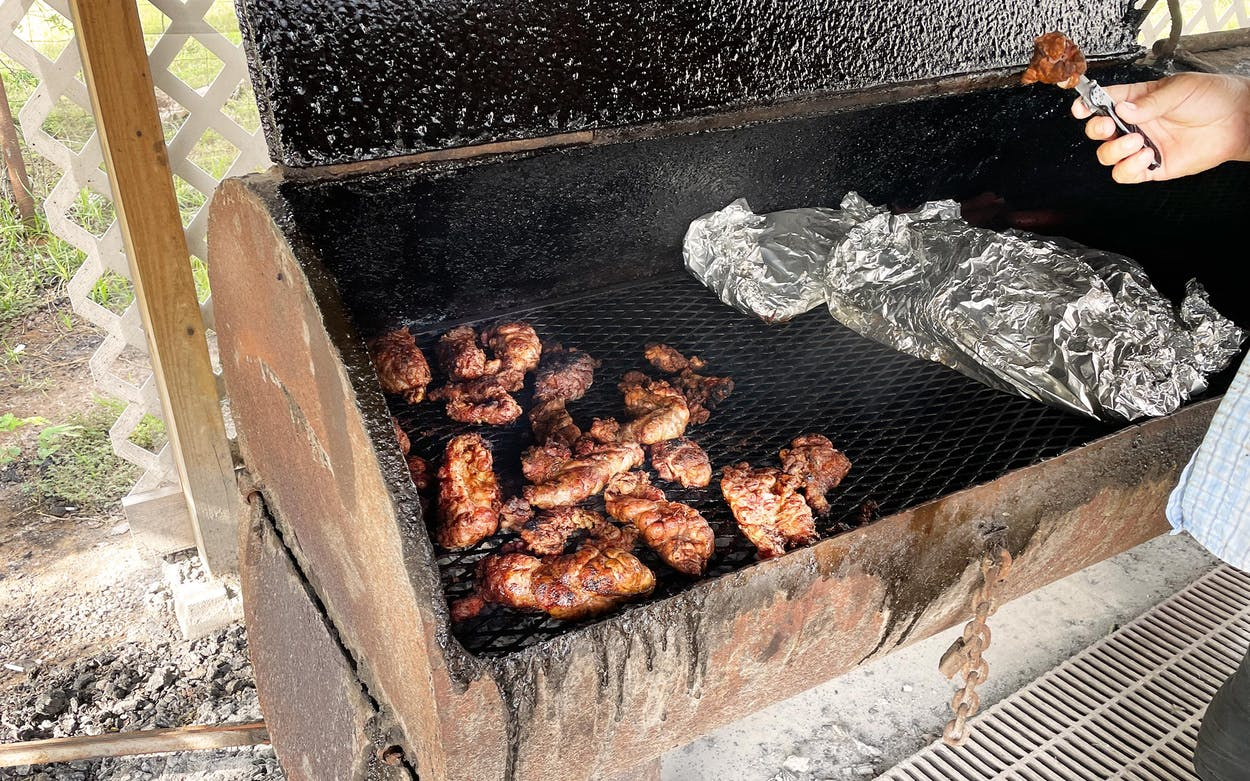 Quintanilla working the pit at Avila's BBQ.
