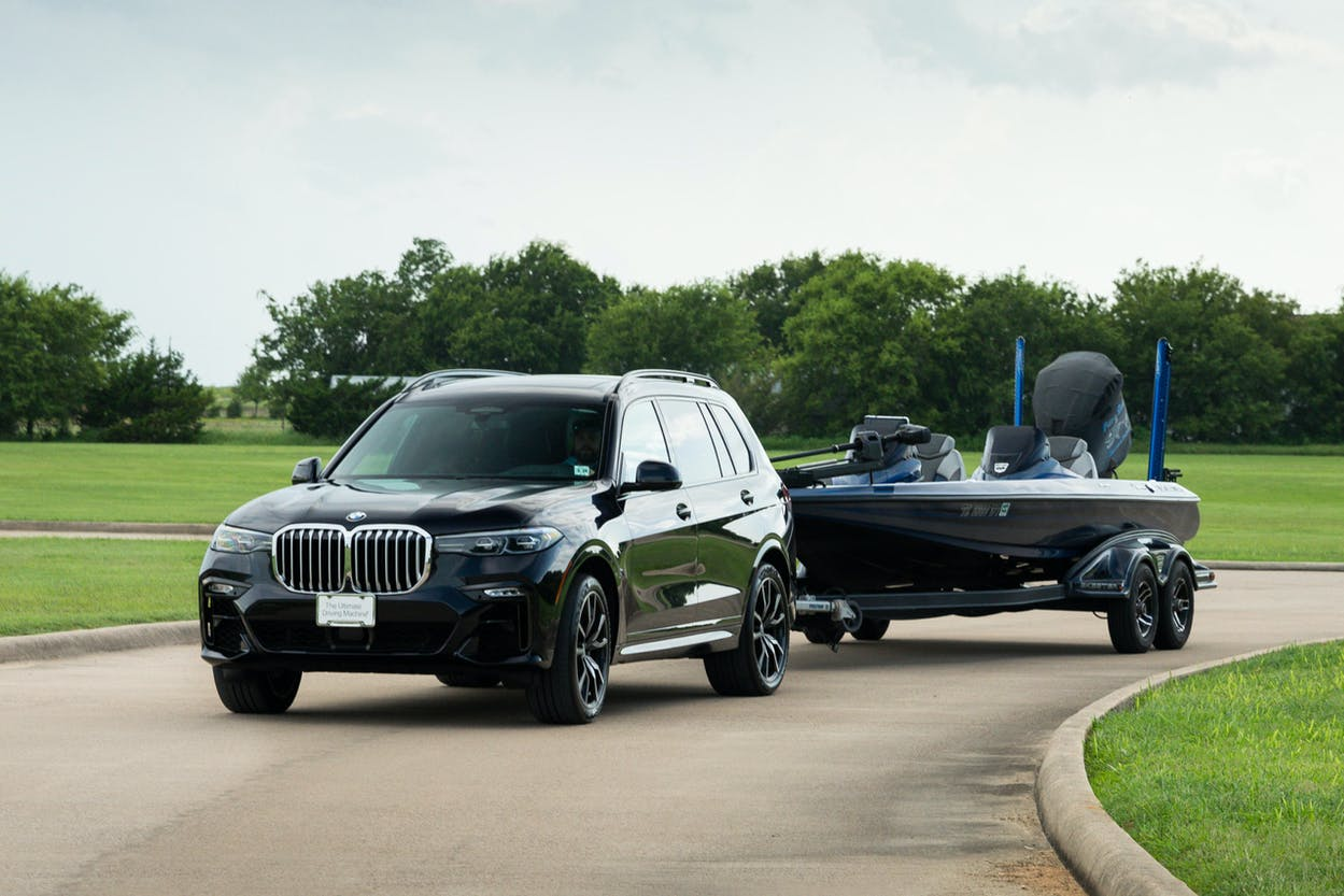 The BMW X7 tows a boat to a lake with excellent noodling spots.