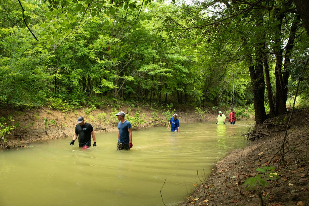 Left to Right: Nathan, Evan, Kyle, Shane, and Will look for catfish holes.