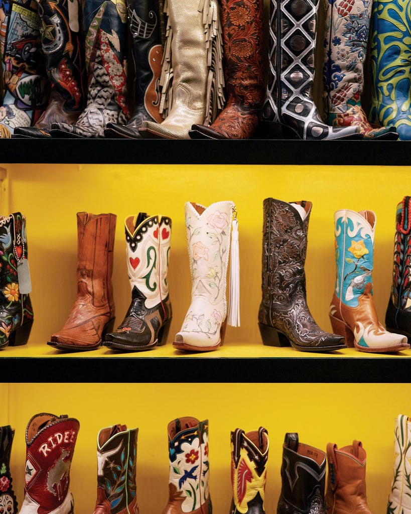 An assortment of styles sit on the shelf at Rocketbuster Boots.