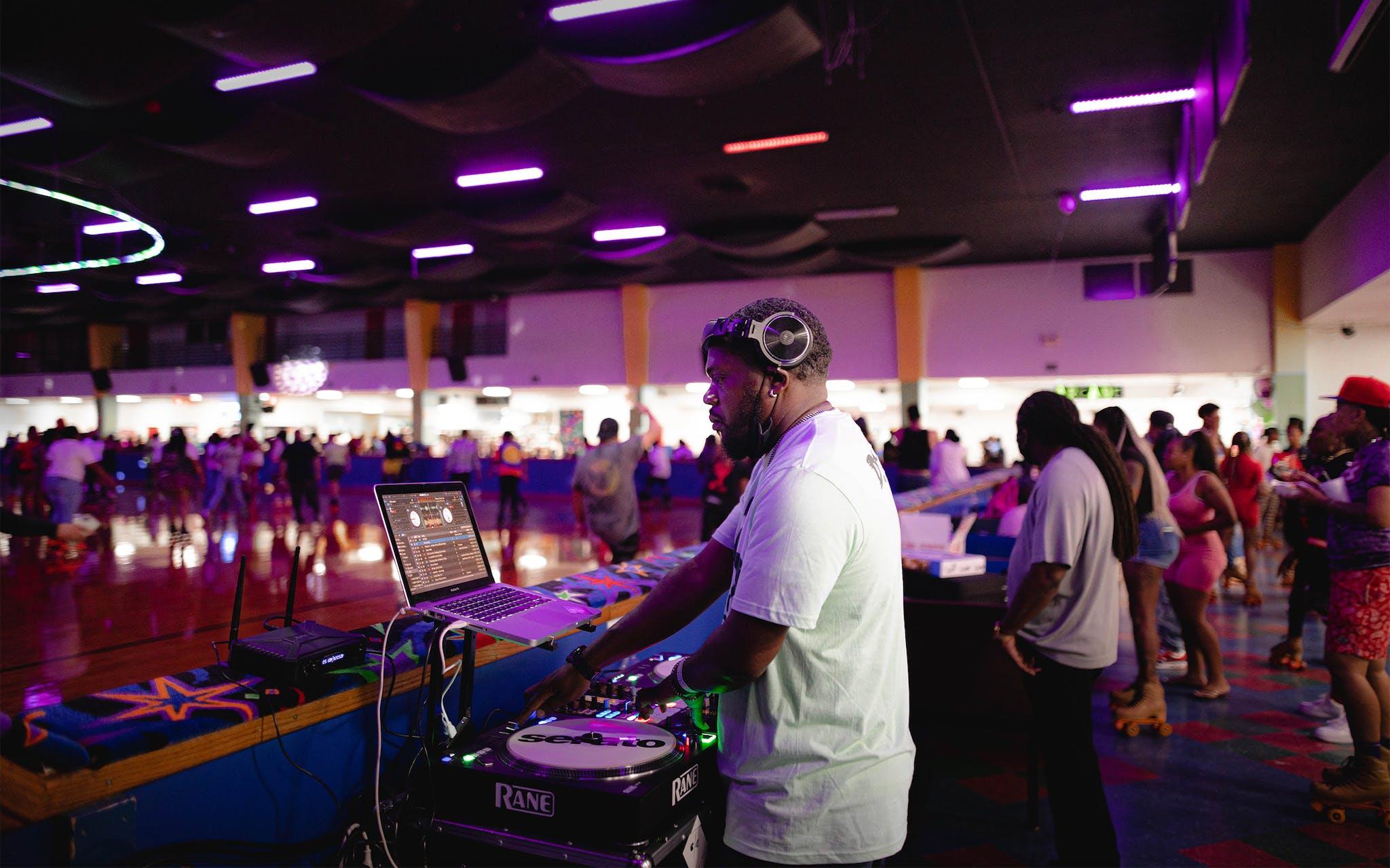 DJ Mike Smoove provides music for the Skate Jam.