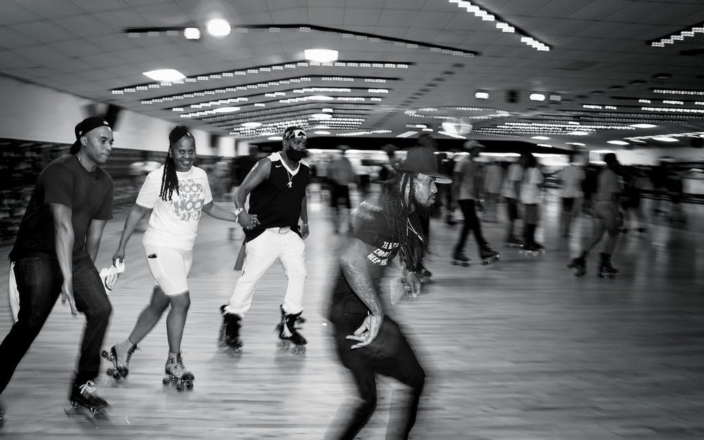 """Wanda """"Gigi"""" Brown (second from left) skates at the """"It's All Wood in My Hood"""" Wood Rydrz Skate Jam at Arlington Skatium on August 14, 2021."""