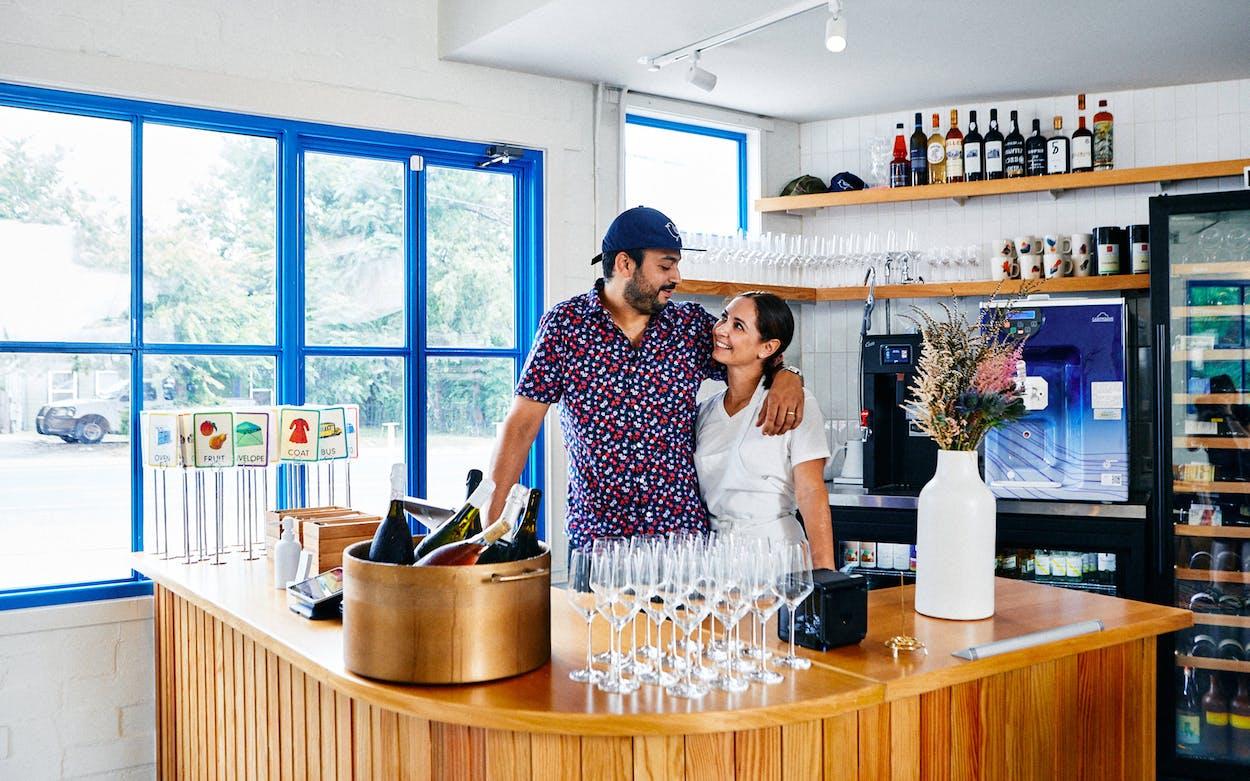 Arjav Ezekiel and Tracy Malechek-Ezekiel stand at the counter of Birdie's, in Austin.