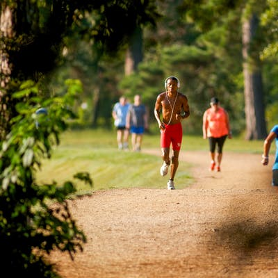 Runners on the Seymour Lieberman trail at Memorial Park in Houston.