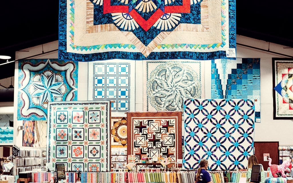 Quilts hanging at Stitchin' Heaven, in Quitman.