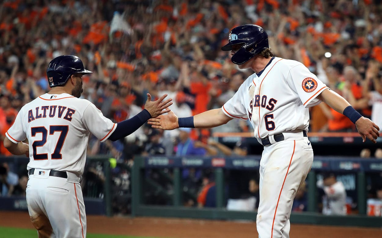 HOUSTON, TEXAS - OCTOBER 07: Jake Meyers #6 and Jose Altuve #27 of the Houston Astros congratulate each other at home plate after scoring during the 4th inning of Game 1 of the American League Division Series against the Chicago White Sox at Minute Maid Park on October 07, 2021 in Houston, Texas.