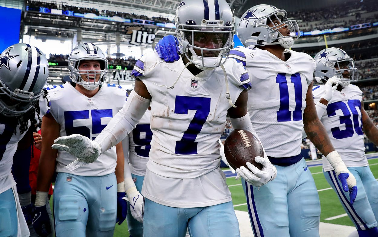 Trevon Diggs #7 of the Dallas Cowboys celebrates after an interception during the third quarter against the Carolina Panthers at AT&T Stadium on October 03, 2021 in Arlington, Texas.