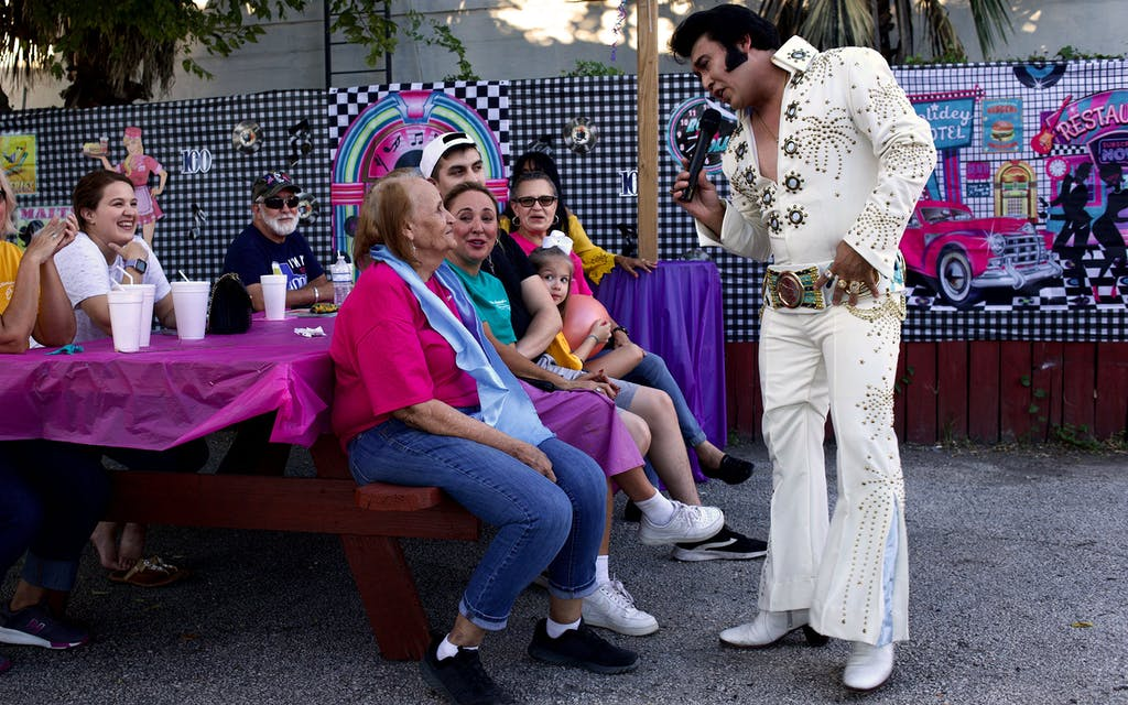 Elvis impersonator Travis Hudson sings a love song to Mary Ann Hill.