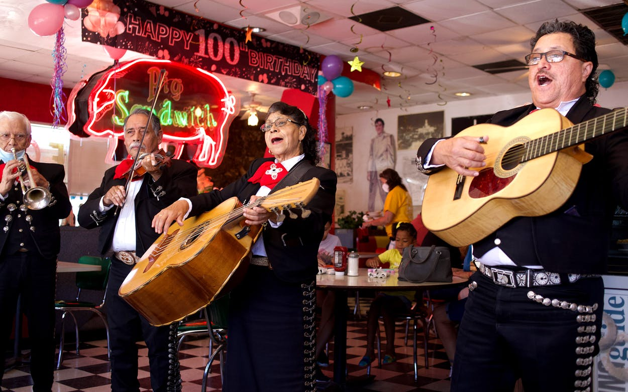 The group Mariachi Aguila Castila performs at the Pig Stand.